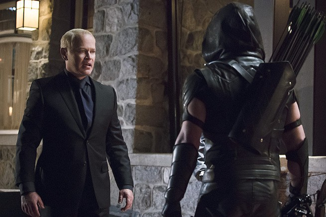 Neal McDonough as Damien Darhk and Stephen Amell as The Arrow