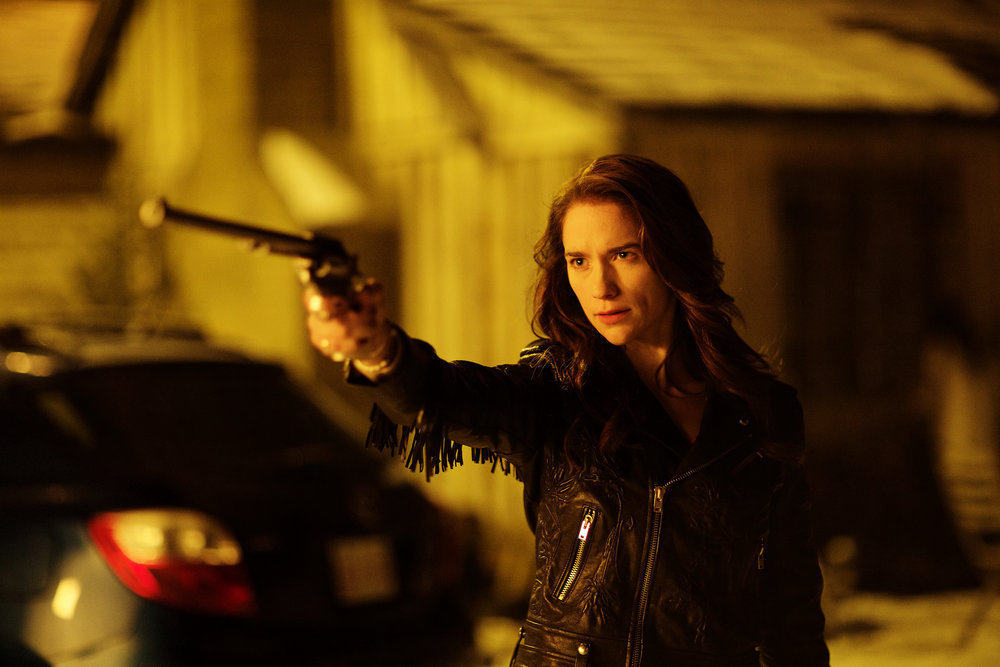 "WYNONNA EARP -- ""Walk After Midnight"" Episode 107 -- Pictured: Melanie Scrofano as Wynonna Earp -- (Photo by: Michelle Faye/Syfy/Wynonna Earp Productions)"