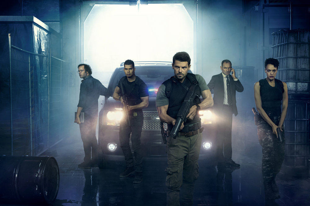 HUNTERS -- Season:1 -- Pictured: (l-r) Gareth Davies as Jules Callaway, Mark Coles Smith as Dylan Briggs, Nathan Phillips as Flynn Carroll, Lewis Fitz-Gerald as Truss Jackson, Britne Oldford as Allison Regan -- (Photo by: Peter Brew-Bevan/Syfy)