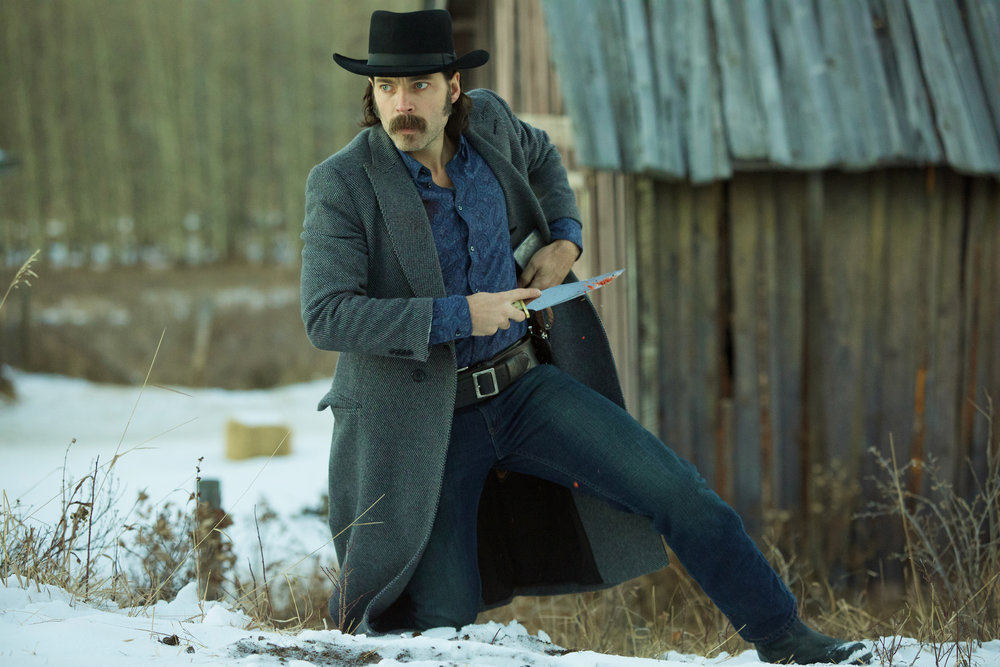 """WYNONNA EARP -- """"Walk After Midnight"""" Episode 107 -- Pictured: Tim Rozon as Doc Holliday -- (Photo by: Michelle Faye/Syfy/Wynonna Earp Productions)"""