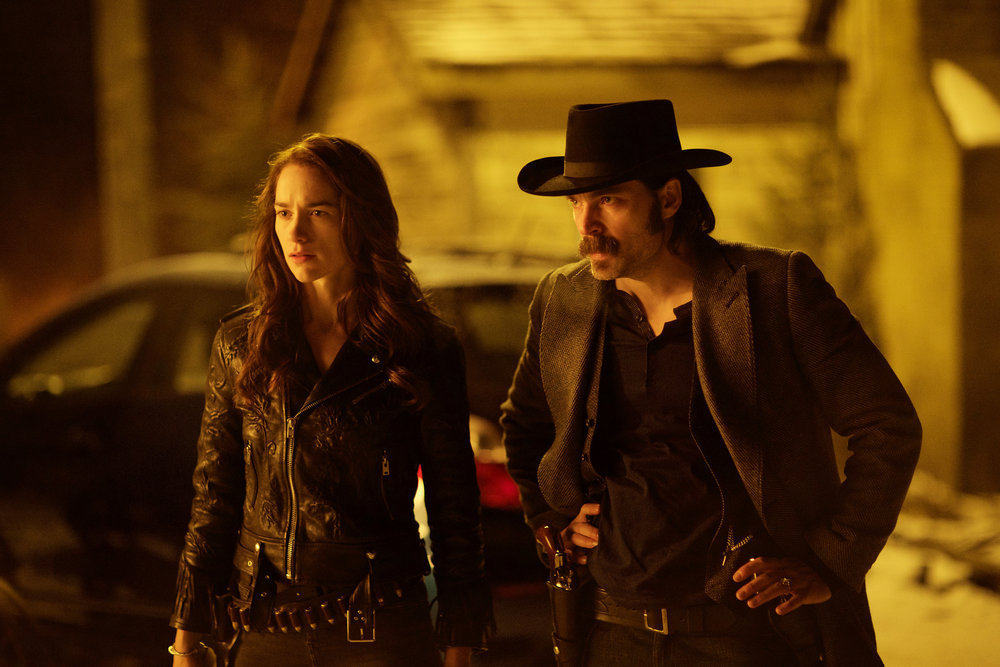"""WYNONNA EARP -- """"Walk After Midnight"""" Episode 107 -- Pictured: (l-r) Melanie Scrofano as Wynonna Earp, Tim Rozon as Doc Holliday -- (Photo by: Michelle Faye/Syfy/Wynonna Earp Productions)"""