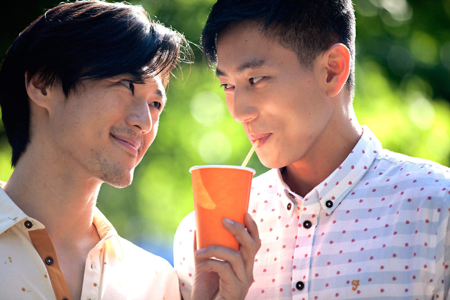 From L to R: Ning (James Chen) and Ryan (Jake Choi) with orange juice in Ray Yeung's FRONT COVER